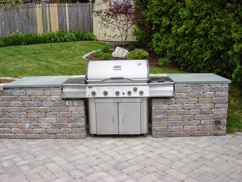 Outdoor Kitchens (20) Built in freestanding grill with bluestone tops